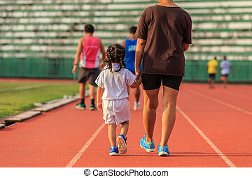Mother holding her daughter hand and walking in running...