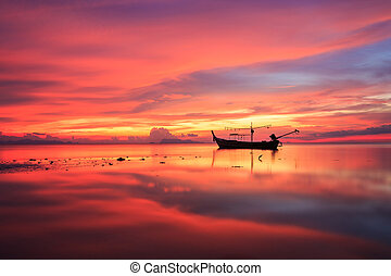 Silhouette traditional longtail boat and beautiful red sky...