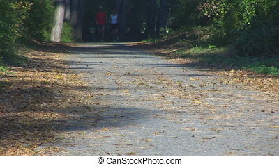 couple running down road, legs part I - couple running down...