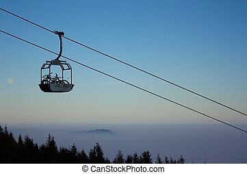Mountain bike uphill transport in basket of cable-car...