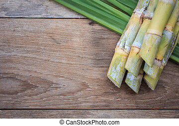 Top view fresh sugar cane and leaf on wooden background