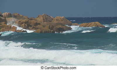 rough sea on la digue - powerful whitecaps rolling in and...