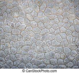 Pattern of grey and rough stone wall texture for background...