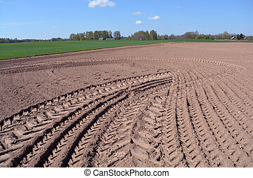 Freshly plowed earth on farm field