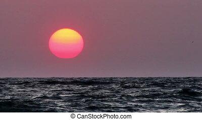 sunrise over the sea - sunrise over the stormy sea