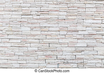 Pattern of natural stone wall and flower plant. Garden...