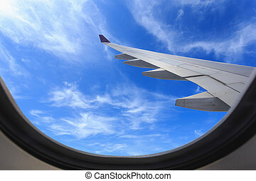 View of beautiful cloud and wing of airplane from window -...