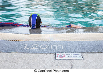 NO DIVING sign on the side of swimming pool - Close up NO...