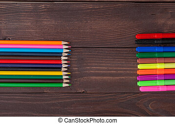 Colored pencils on a wooden board. School supply with copy...
