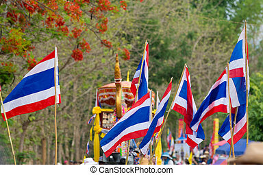 Thai flag parade in wax festival in Thailand.