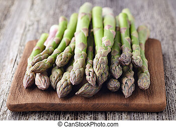 Asparagus on a wooden board