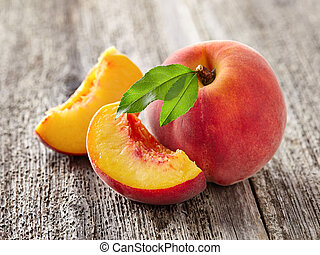 Peaches on a wooden board