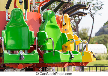 Colorful roller coaster seats at amusement park in Thailand