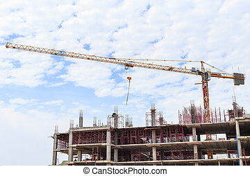Big construction crane and the building against the sky...