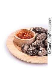 Boiled blood cockle with sauce isolated on white background...