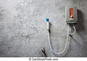 Water heater on the grey cement wall in bathroom - Old water...
