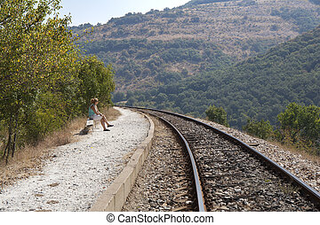 Woman Waiting for a Train - Woman without baggage waiting...