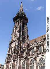 Main tower of world famous Freiburg Muenster cathedral, a...