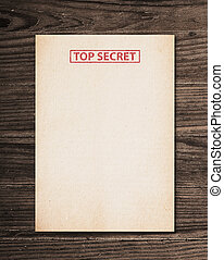 Top secret document - Top secret document on old wooden...