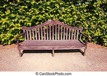 Old, English bench in the garden