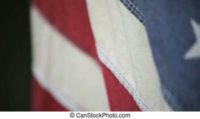 American flag in a strong wind - close up of an old American...