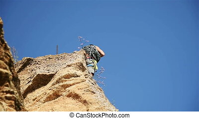 Climber Clears The Rope - Climber Standing On Top Rock And...