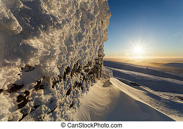 Snow icy wall of the old lift in the mountains Hibiny