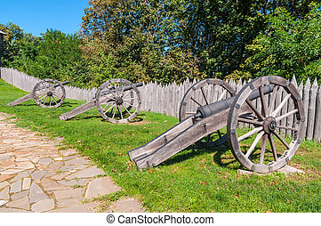 Ancient gun - Old Cossack cannons with wooden wheels are...