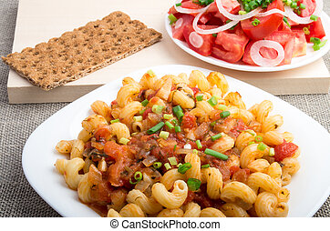 Cooked pasta cavatappi served with a salad of tomatoes -...