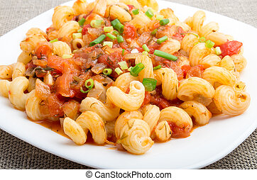 Cavatappi pasta with a sauce of stewed vegetables - Close-Up...