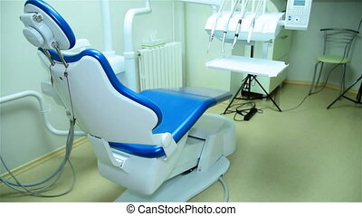 Dental Office With Blue Chair And Tools