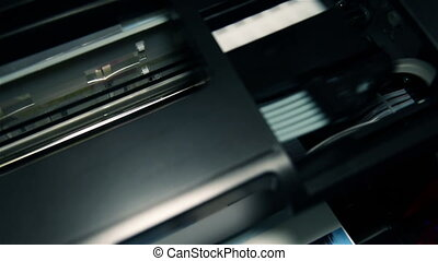 Continuous Ink Feed Printer Printing Photo. Extreme Close...