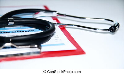 Stethoscope And Medical Card On Table. Close Up