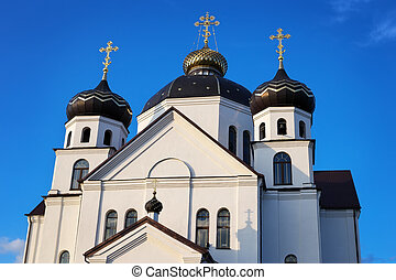 Orthodox Church with domes against the blue sky