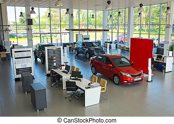 Sale of cars in the showroom. New cars in the showroom.