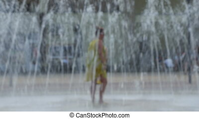 girls dancing at the fountain - two girls dancing in the...