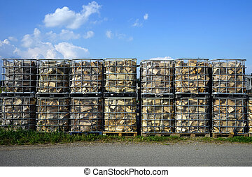 Boxes with firewood - Asphalt road near boxes with firewood...