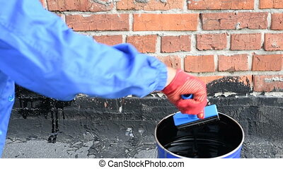 priming brick wall - Roofer covered brick wall, bitumen...