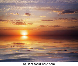 Beautiful colorful sunset sky and ocean. Sunrise in the sea. Sky background