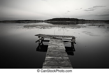 Old Wooden pier on the lake. Black and White