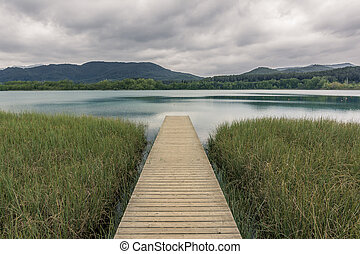 wooden walkway leading to the lake. Vanishing point - wooden...