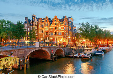 Amsterdam City Canal at night - A view of the picturesque...