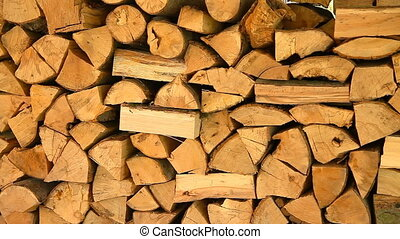 Firewood stacked in a woodpile. Drying and storage of wood...