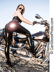 Sexy woman in a leather clothes near the bike - Sexy young...