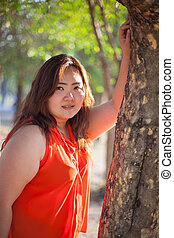 happy fatty woman - happy fatty asian woman outdoor in a...