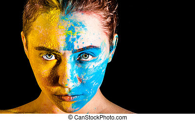 Woman covered with yellow and blue paints - Beautiful young...