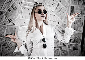 Blonde surrounded with newspapers - Young blonde in a...