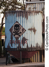 Toxic waste symbol on a blue barrel