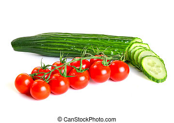 Red cherry tomatoes and green cucumber isolated on white...