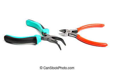 Needle-nose pliers and cutters isolated over white...
